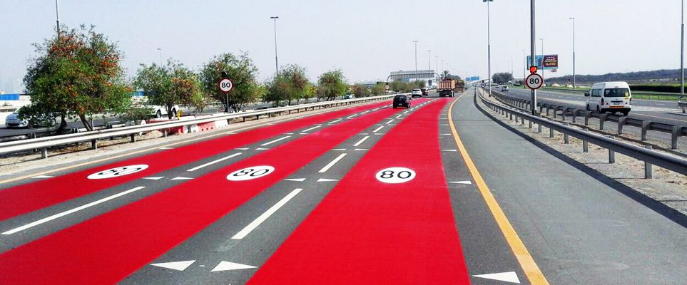 dubai roads are being painted red to show changes in speed limits