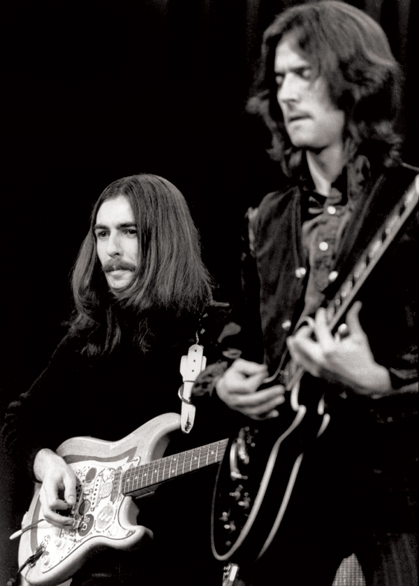 Eric Clapton with George Harrison