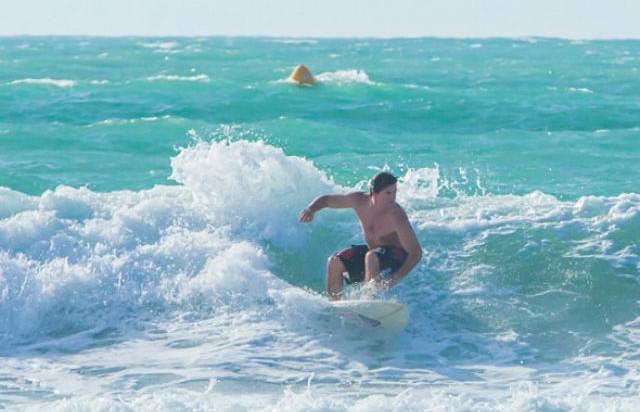 Surfing At Sunset Beach
