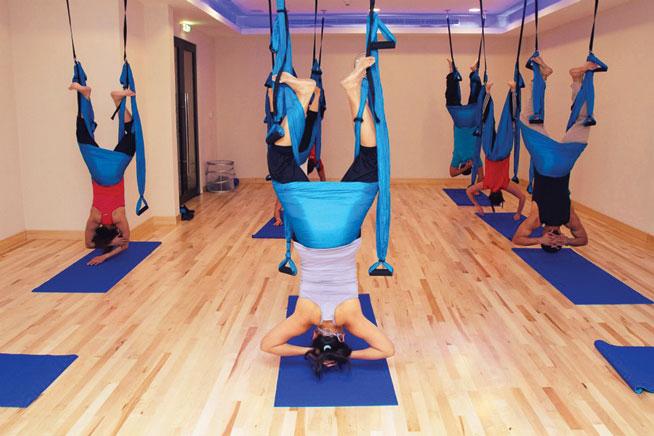 Offbeat sports in Dubai - Swing Yoga