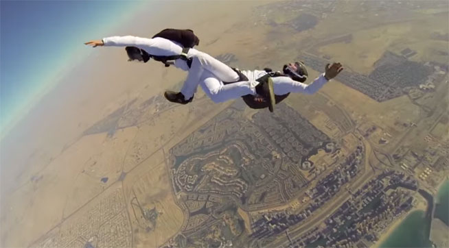 Dancing skydiving over The Palm