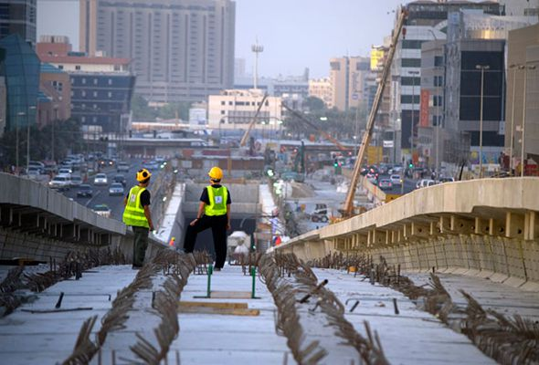 Construction workers on the Dubai Metro tracks