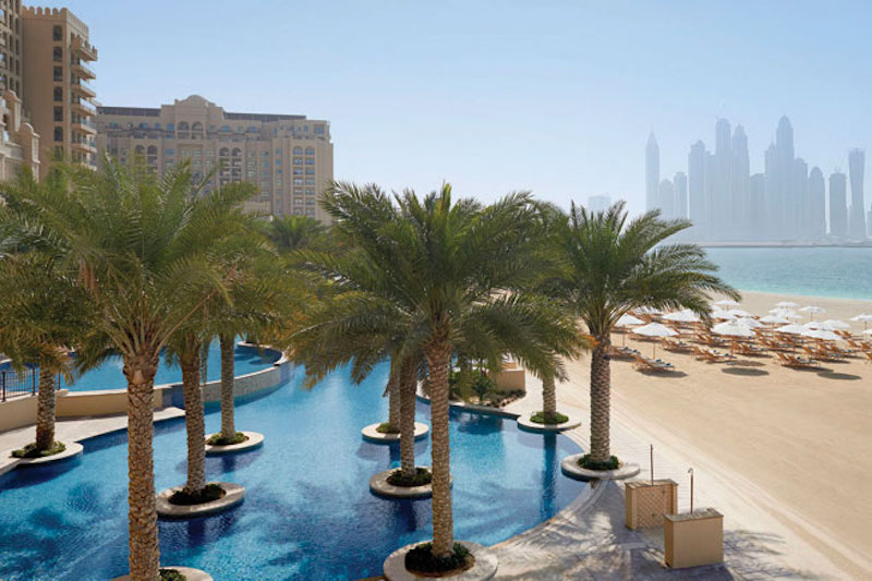 TRAVEL-Fairmont-The-Palm-Family-pool-with-Dubai-Marina-skyline-view-at-the-background