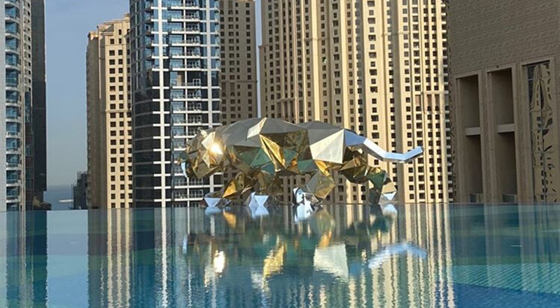 Huge gold tiger and a gorilla statue were helicoptered through Dubai